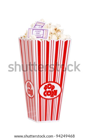 Popcorn in bucket with movie tickets - stock photo