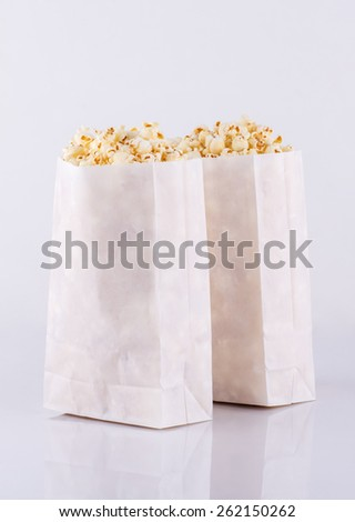Popcorn in paper bags isolated on white background
