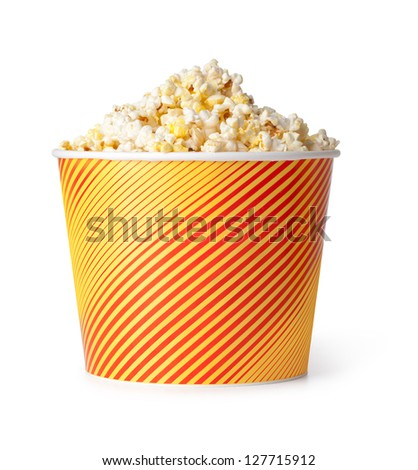 Popcorn in red and yellow cardboard box on a white background - stock photo