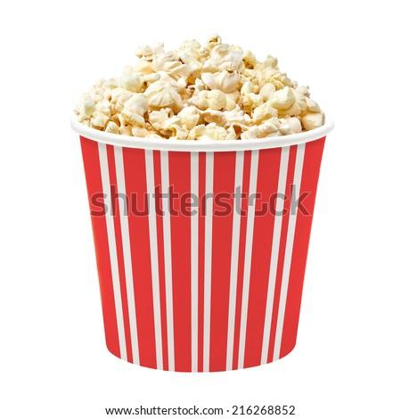 Popcorn in striped bucket on white background - stock photo