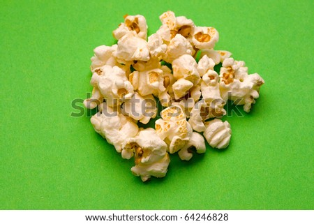 Popcorn isolated on green - stock photo
