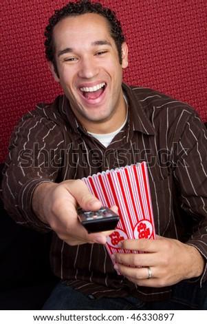 Popcorn Man Watching TV - stock photo