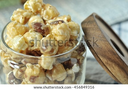 popcorn mix with caramel and almond, sweet and delicious snack, homemade. - stock photo