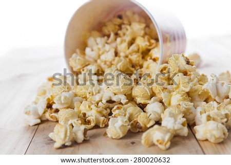 Popcorn on a wooden table