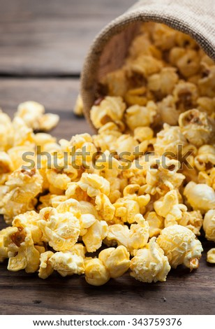 popcorn on wood table. Selective focus.