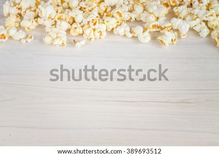 popcorn on wooden background. - stock photo