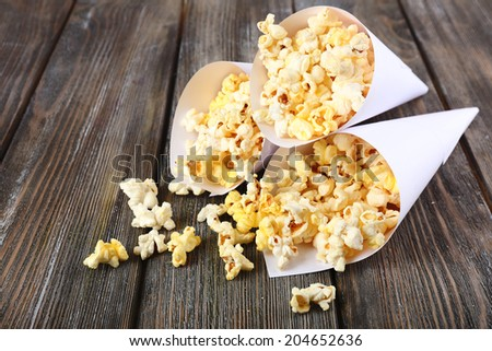 Popcorn on wooden table, close up - stock photo