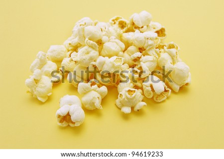 Popcorn on yellow background
