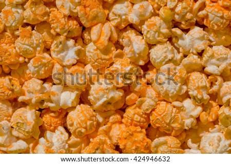 Popcorn texture ready to eat with powdered sugar. Fast-food background - stock photo