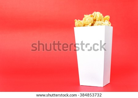 popcorn white box on red background - stock photo