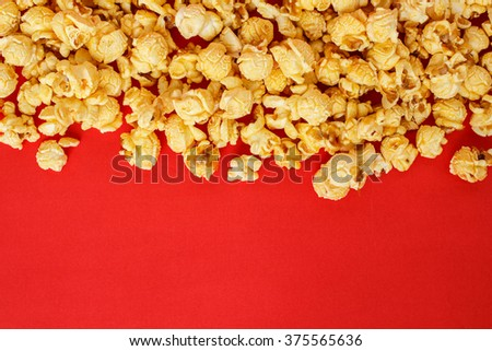 popcorn white pile on red background - stock photo