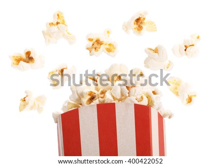Popcorn with flying kernels from red white cardboard box - stock photo