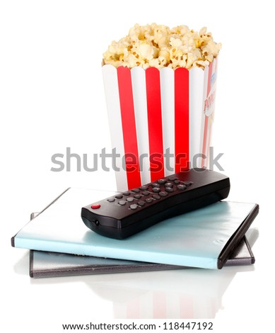 popcorn with TV control panel and disks isolated on white - stock photo