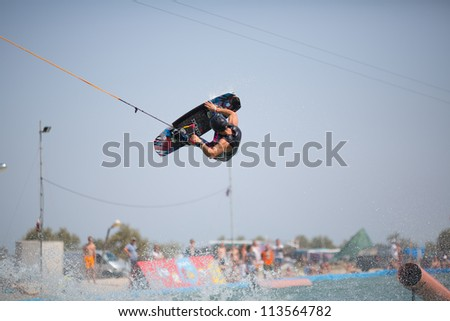 "POPOVKA, UKRAINE - AUGUST 23. Unknown surfer in competition ""Z-Games 2012"" on august 23, 2012 in Popovka, Ukraine"