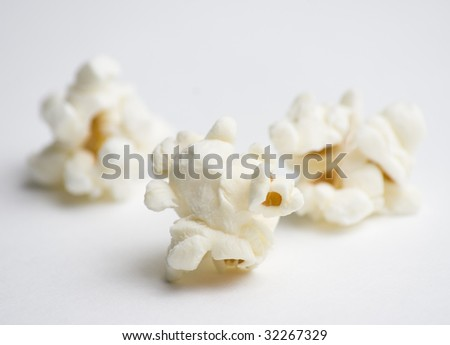 Popped popcorn on white - stock photo