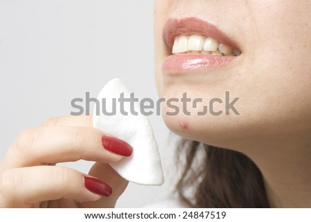 Popping a zit - stock photo
