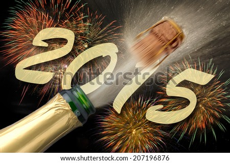 popping Champagne and firework for new year 2015 - stock photo