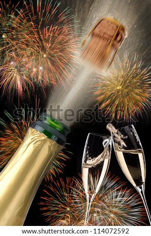 popping champagne at new year - stock photo