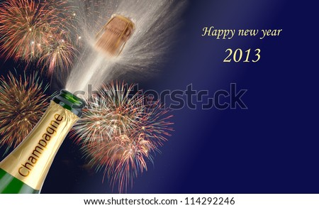 popping champagne with firework at new year 2013 - stock photo