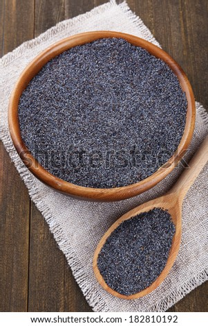Poppy seeds on table close-up - stock photo