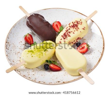 popsicle. Glazed chocolate ice cream. Berries, summer food. Isolated - stock photo