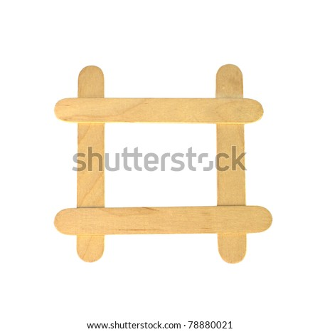 Popsicle sticks arranged in a frame formation isolated on a white background