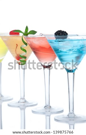 Popular alcoholic cocktails composition. Many cocktail drinks Blue hawaiian, mai tai, tropical Martini, tequila sunrise, margarita cherry, lime, lemon, straw on a white background - stock photo