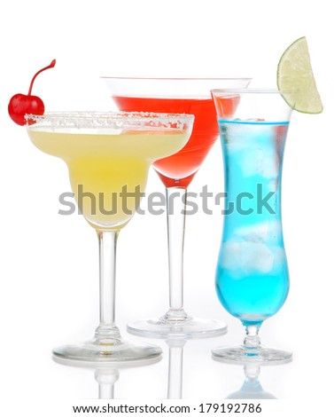 Popular alcoholic cocktails composition. Three cocktail drinks yellow margarita cherry blue curacao and tropical Martini on a white background - stock photo