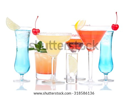 Popular alcoholic cocktails drinks yellow margarita cherry blue curacao and tropical lemon Martini on a white background - stock photo