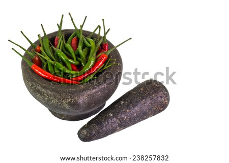 Popular granite Mortar full with red and green goat pepper. - stock photo