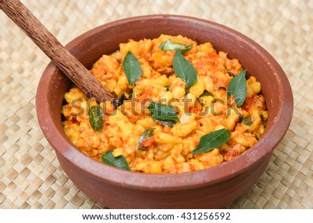 Popular traditional South Indian food cooked young jackfruit /  jakfruit  / jack /  jak with turmeric, chilly, grated coconut in earthen ware Kerala, India. served with fish curry. Indian food, spices - stock photo