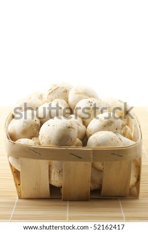 Porcelain agarics in retail bast basket on mat.