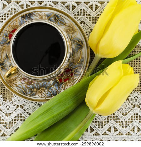 Porcelain coffee cup with yellow flowers - stock photo