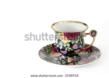 Porcelain cup decorated by roses (handiwork) - stock photo
