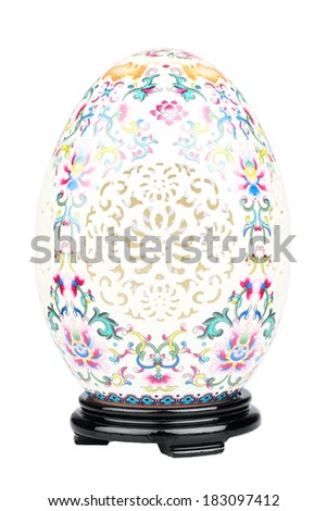 Porcelain decorated easter egg with stand isolated on white