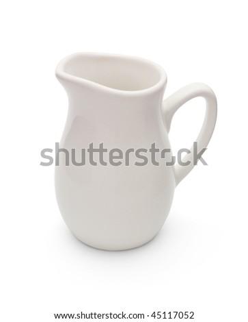 Porcelain milk jug isolated on white - stock photo