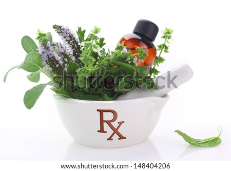 Porcelain mortar with rx symbol and fresh herbs - stock photo