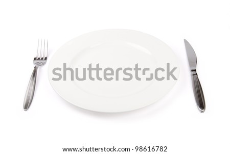 porcelain plate with fork and knife isolated on white - stock photo