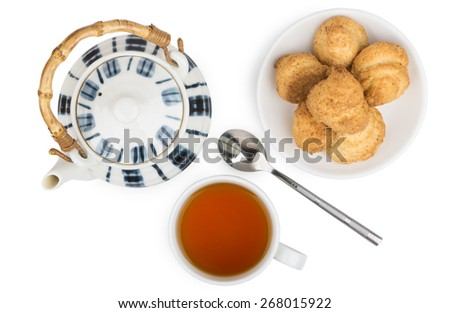 Porcelain teapot, cup of tea and biscuits on  saucer isolated on white background - stock photo