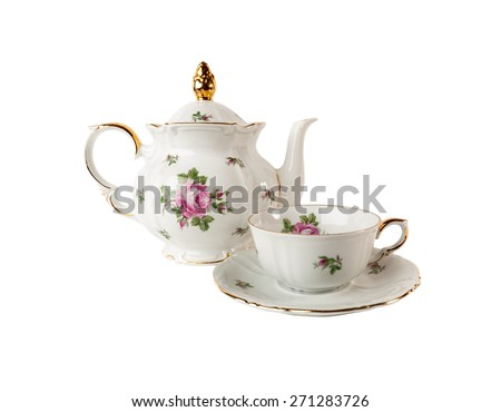 Porcelain teapot, teacup and saucer with floral rose ornament  in classic style isolated over white - stock photo