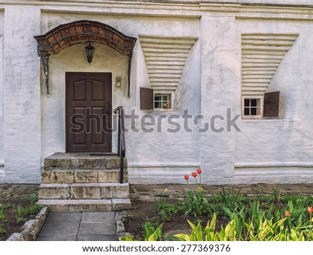 Porch and small windows of the building in Novospassky monastery, Moscow, Russia. - stock photo
