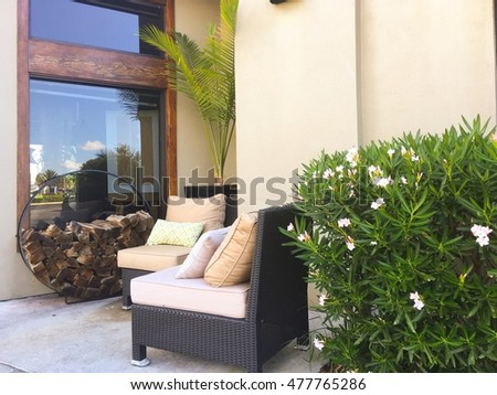 Porch sofa and wood fire outside  for interiors  garden, backyard, front yard