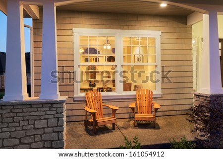 Porch with Interior View and chairs outside of New Luxury Home - stock photo