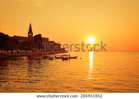 Porec View at Sunset. Medieval Mediterranean City in Croatia. Popular Tourist Resort of Istria at Adriatic Sea. Copy Space. Toned Photo. - stock photo