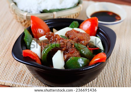 Pork braised in spicy barbecue sauce wit steamed rice - THIT HEO RIM MAN - typical Vietnamese cuisine. - stock photo