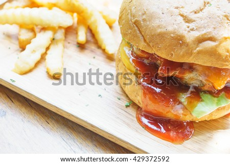 pork cheese burger and french fries