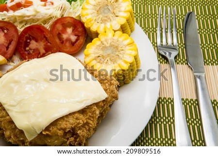Pork chop Cordon bleu, with French fries and vegetables garnish - stock photo