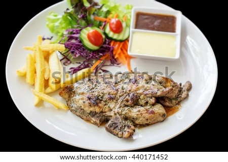 Pork chop steak and french fries. - stock photo