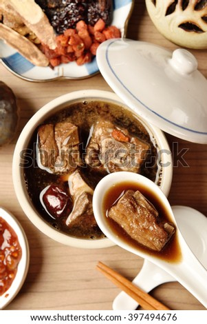 Pork chops in Chinese medicine soup.   - stock photo