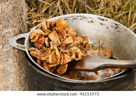 Pork crackling (pork skin) in boiling oil